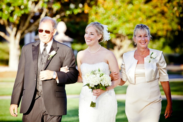 parents of the bride walk down the aisle