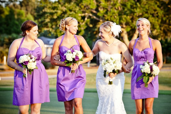 bridesmaids in short purple dresses