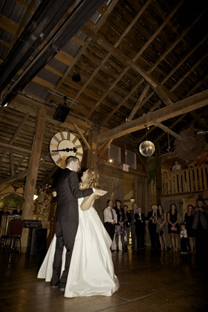 first dance of bride and groom in barn