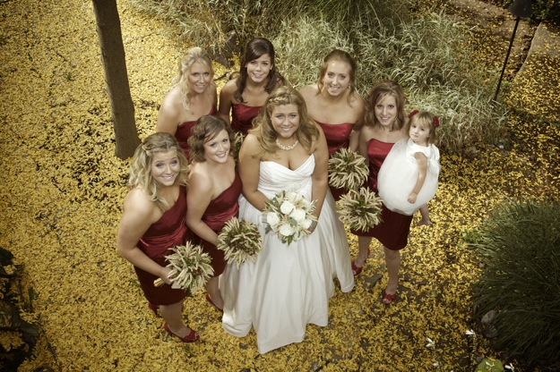 bridesmaids in red surround the bride