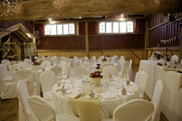 wedding tables inside barn