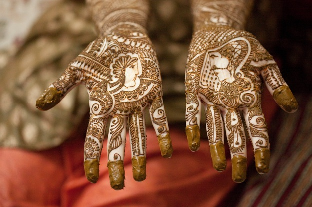 hands of bride with henna