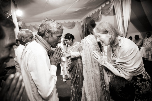 multicultural wedding guests greet each other