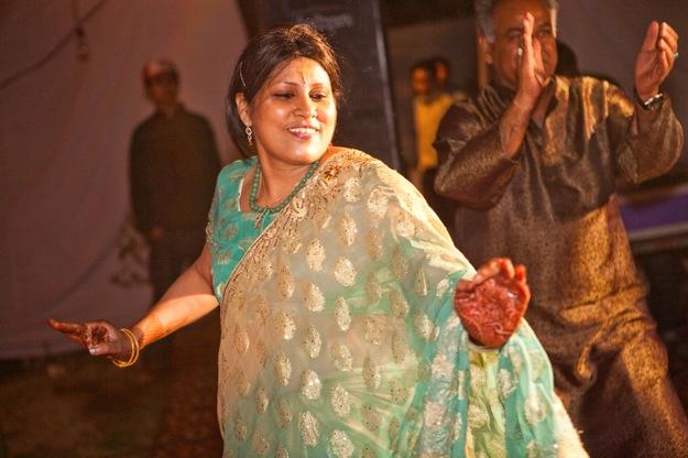 guest in green sari dances at wedding