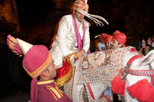 Indian groom rides horse