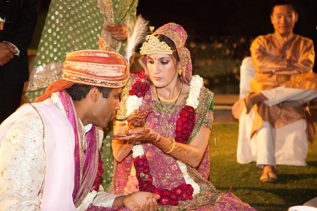 bride at Indian wedding serves groom
