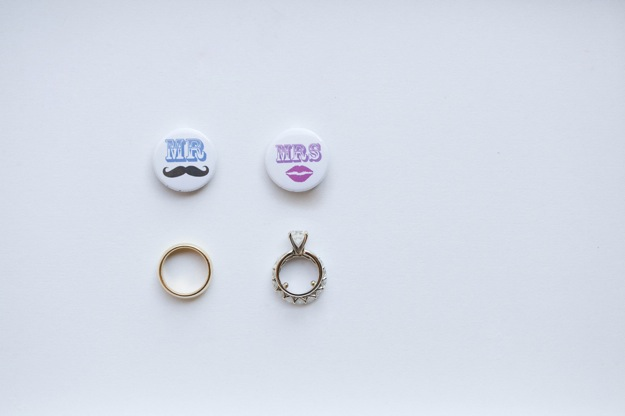 bride and groom pins with wedding rings
