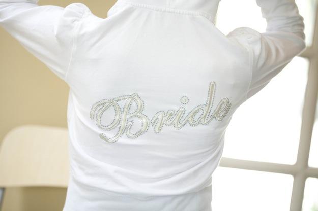 bride in white sweatshirt with bride on it