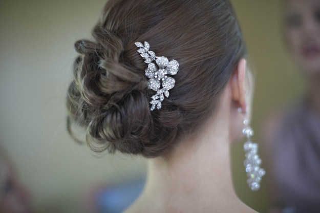 bride with diamond headpiece and long earrings