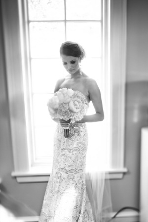 bride in strapless dress with flowers