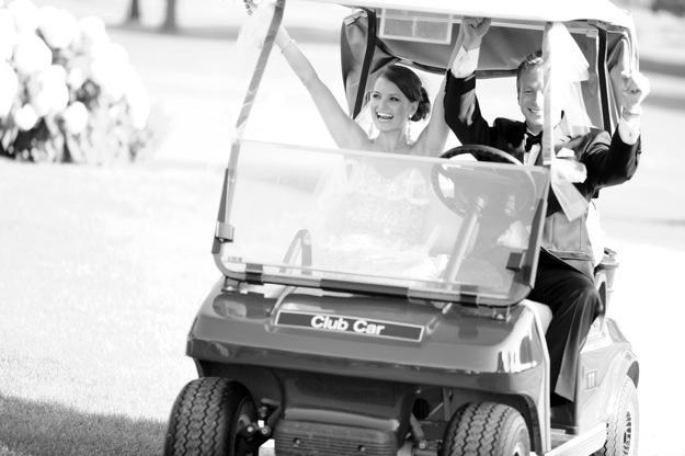 bride and groom ride in golf cart