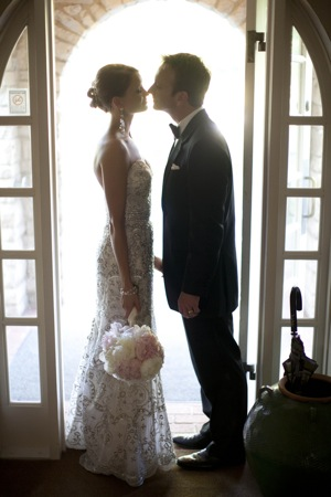 bride and groom almost kiss in doorway