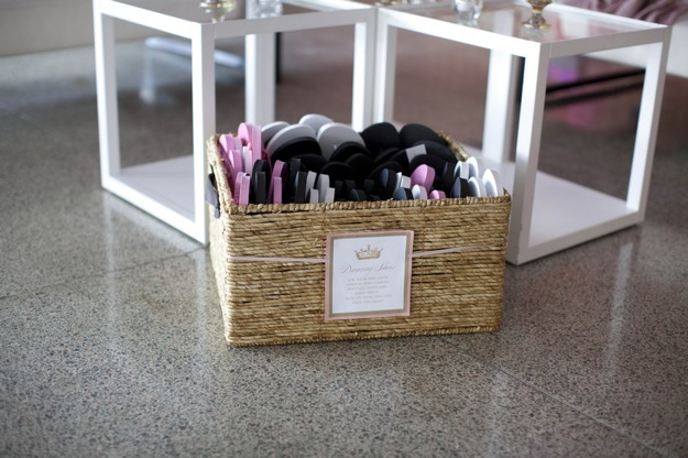 basket of flip flops at wedding