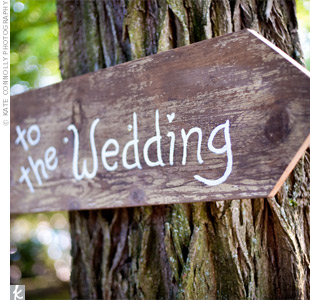wooden sign with to the wedding on it