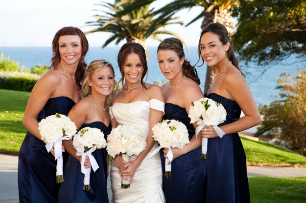 bridesmaids in navy blue strapless dresses