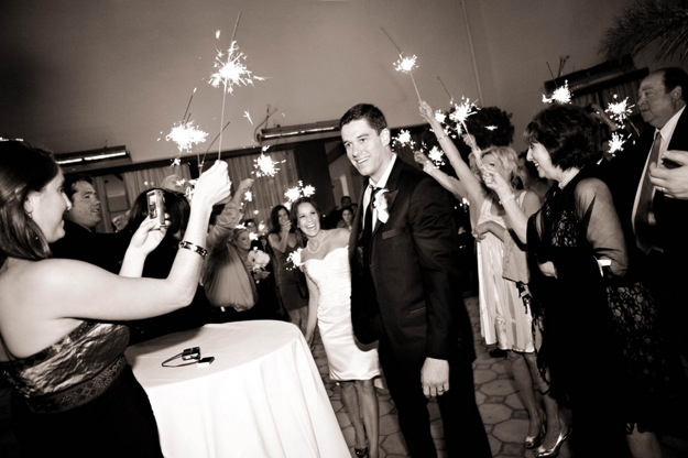bride and groom leave to sparklers