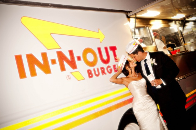 Bride and groom kiss at in and out burger food truck