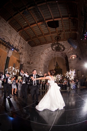 energetic bride and groom fast dance
