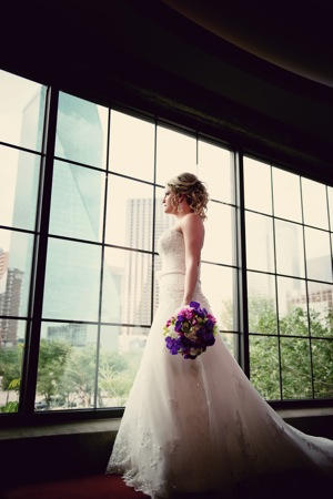 bride with flowers in front of windows