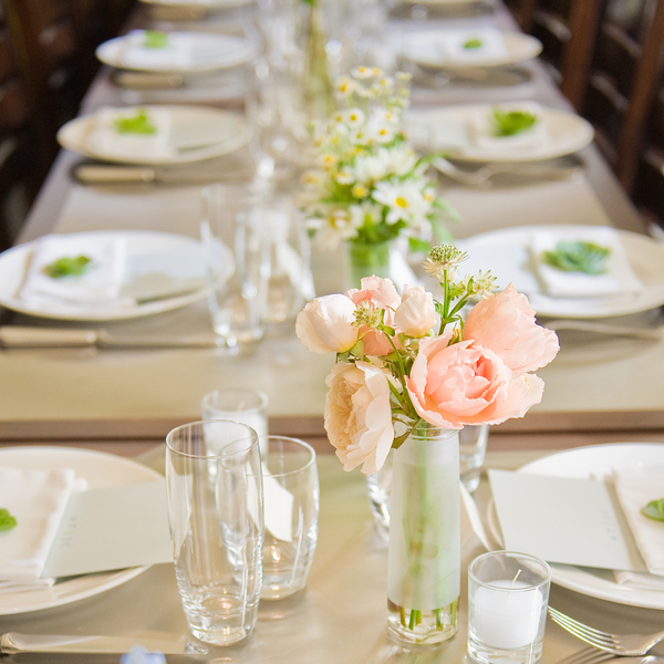 family style wedding table with pink roses and green accents