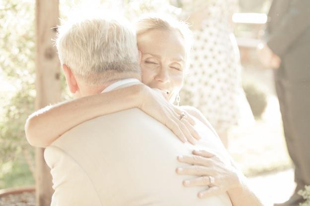 mature bride and groom hug