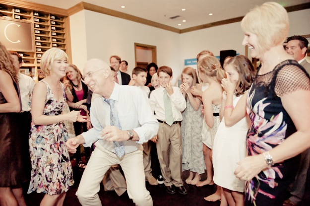 guests dance energetically at wedding