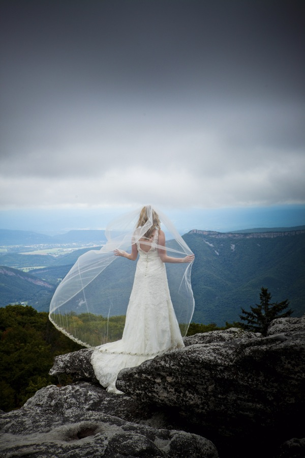 wedding photography bride on mountain top with veil flowing