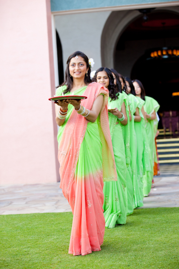 bridesmaids in green and pink saris