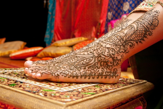foot decorated with henna for Indian wedding