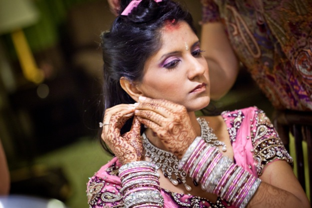 Indian wedding jewelry being worn by bride