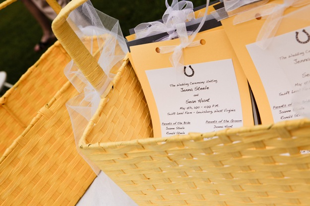 basket of yellow wedding programs