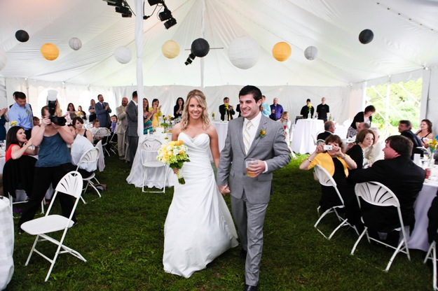 yellow and grey decorated wedding tent for reception