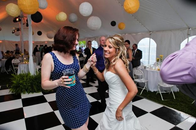 friend and bride dance