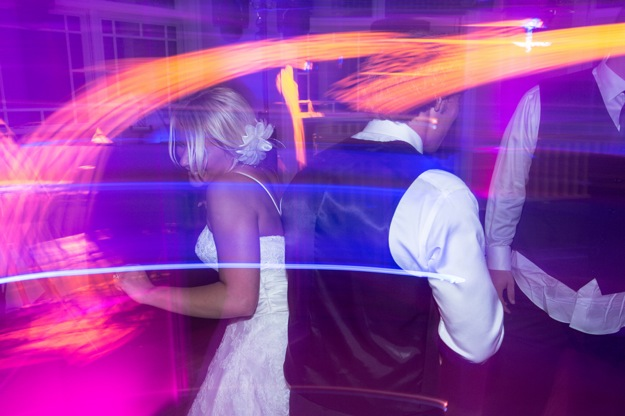 lighting effects bride and groom dance
