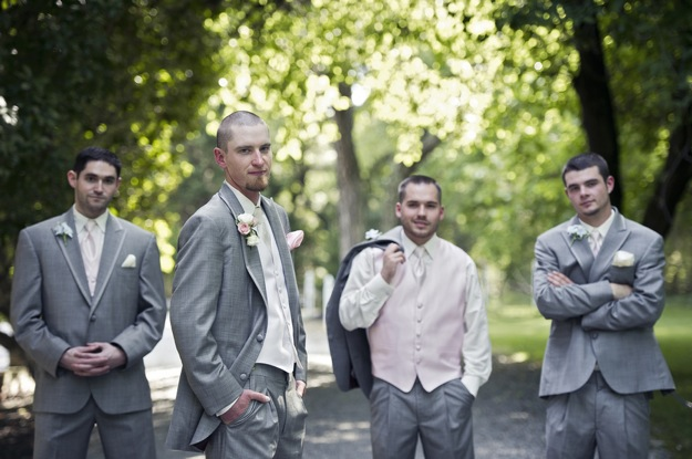 groom and groomsmen in gray tuxedos with pink accents