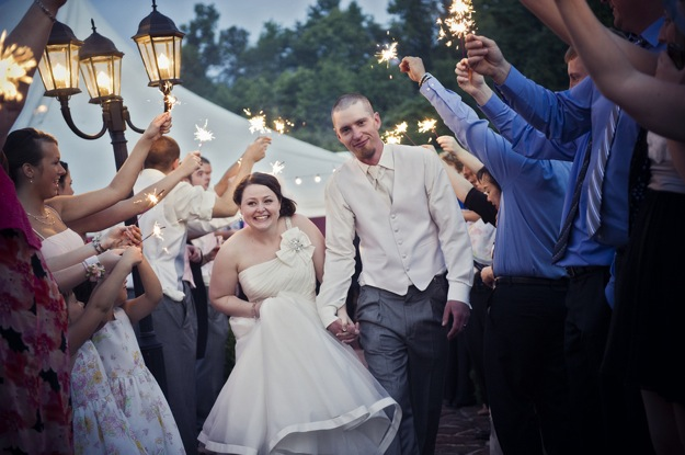 sparklers show bride and groom out of wedding