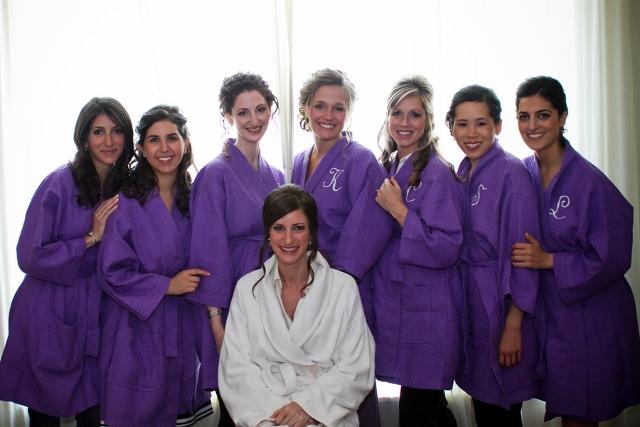 bridesmaids in purple robes before wedding