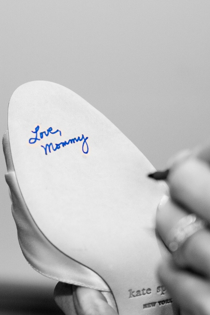 mother signs bride's Kate Spade bridal shoe