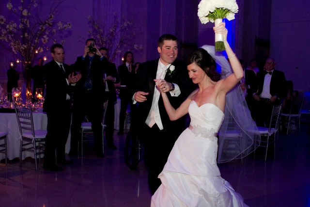 bride and groom enter reception dancing