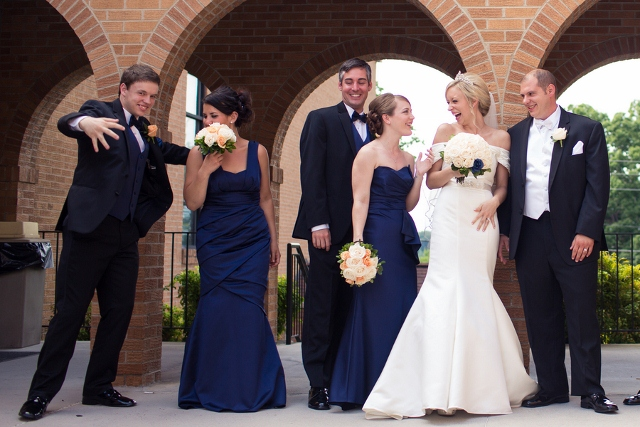 bridal party in blue and black goofing off