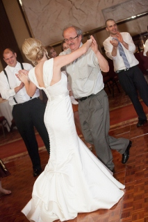 father of the bride and elegant bride dance