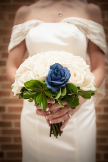 blue flower in white bridal bouquet