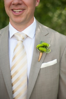 green boutonniere on groom
