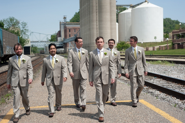 groom and groomsmen in grey suits on street