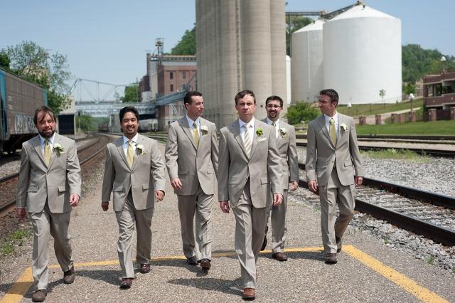 groom and groomsmen in grey suits on street