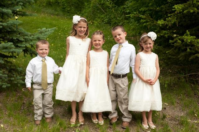 children dressed up for outdoor wedding