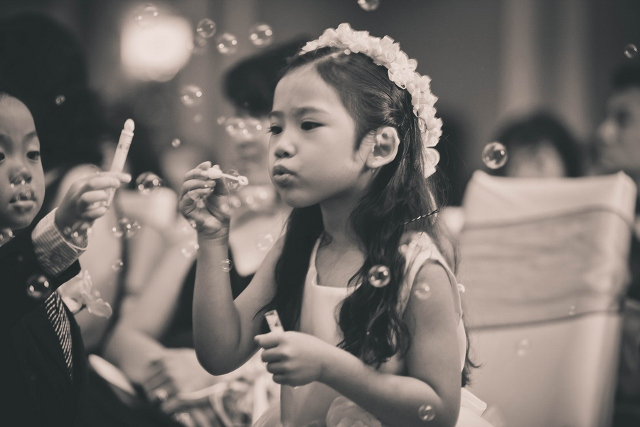 wedding reception with flower girl and bubbles