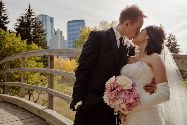 wedding kiss on bridge