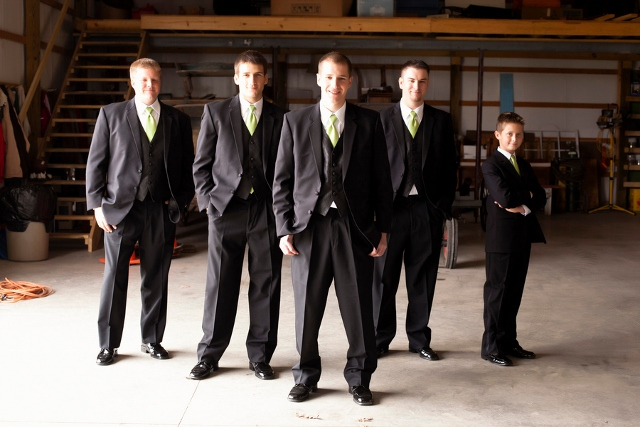 barn location with groom and groomsmen