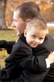 groom hugs young ring bearer